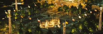 High angle view of fountains in a park lit up at