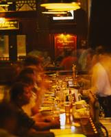 High angle view of a group of people at a bar cou