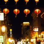 """Lanterns hanging across a street"" by Panoramic_Images"