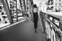 Young woman walking on a Bridge
