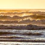 """Amber Sunset Ocean Waves"" by JBentley"