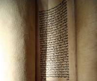 Ancient Torah scroll open to