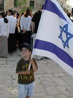 Boy with Israeli Flag outside Machpela