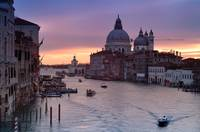Canal Grande in Venice at sunrise with riding boat