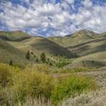 """Spring Cloud Shadows on Hills of Demorat Gulch"" by JBentley"