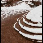 """Red rock in the snow"" by Melani"
