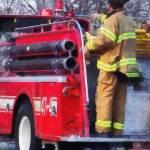 """Fireman on Back of Fire Truck"" by susansartgallery"