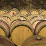 """Oak Barrels in Wine Cellar in Italy"" by petrsvarc"