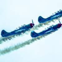 action in the sky during an airshow by Alexandr Grichenko