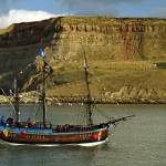 """Bark Endeavour Passing Whitby East Cliff"" by rodjohnson"