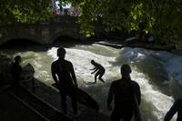 Surfing the Eisbach River in Munich