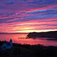 Sunset over Uig bay Art Prints & Posters by Gordon Willoughby