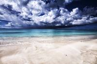 Sand, Sea and Storm clouds in Antigua