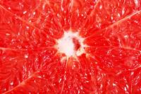 Reddish flesh- pulp of grapefruit. Close up.