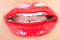 Closeup shoot of beautiful lips of woman with red