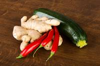 Zucchini, imbir and red hot chilie peppers on kitc