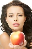 Sexy woman with red apple