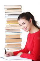 Happy smiling young student woman with books, isol