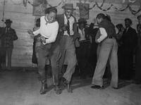 Jitterbugging in Negro juke joint, Saturday evenin