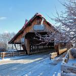 """Wooden Covered Bridge in Winter - Frankenmuth, MI"" by sterk"