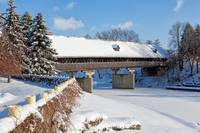 Snow Covered Wooden Bridge on a Winter Day