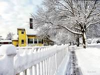 Yellow House with Snow Covered Picket Fence
