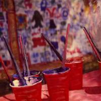 Red Cups With Paint Brushes