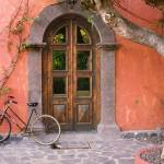 """Doorway and Bicycle, Loreto, Mexico"" by canvass22"