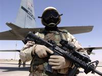 Soldier guards a C130 Hercules and crew
