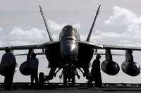 An F/A18E Super Hornet on the flight deck aboard U