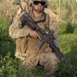 """""""A combat engineer assumes a kneeling position as h"""" by stocktrekimages"""