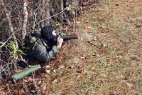 A marksman observer relays intelligence during an