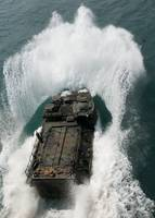 U.S. Marines drive an assault amphibious vehicle i