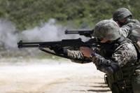 Marines firing shotguns