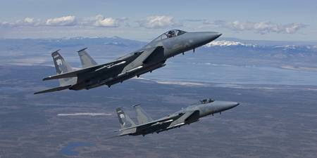 Two F-15 Eagles conduct air-to-air training over O
