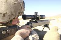 A soldier aims in with his M40A3 Scout Sniper Rifl