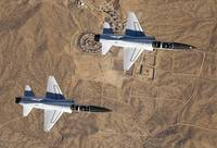 NASA Drydens two T38A mission support aircraft fly