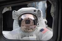 Astronaut peers into the crew cabin of the Space S