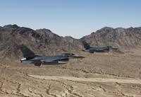 Two F-16s fly in formation over the Arizona desert