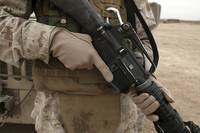 A Marine displays the required hand personal prote