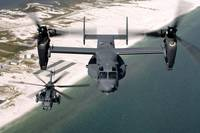 A CV22 Osprey and an MH53 Pave Low fly over the co