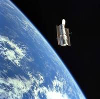 The Hubble Space Telescope with a blue earth in th