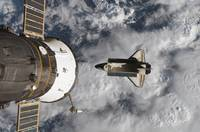 Space Shuttle Atlantis and the docked Soyuz spacec