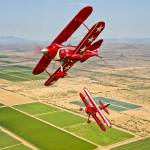 """Two Pitts Special S-2A aerobatic biplanes in fligh"" by stocktrekimages"