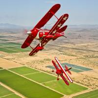 """Two Pitts Special SA aerobatic biplanes in fligh"" by StockTrek Images"