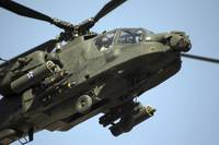 An AH64 Apache in flight over the Baghdad Hotel in