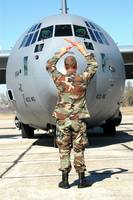 Senior Airman guides a C130 Hercules into its park