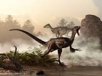 A pair of velociraptors patrol the shore of an anc