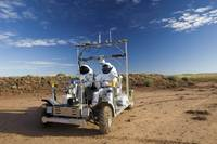 Two astronauts take a ride on SCOUT during Desert