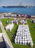 US Navy Sailors attend an establishment ceremony